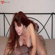Horny mature slut fucking and sucking on her bed