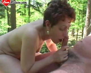 She gets a mouth full of cum in the middle of the woods