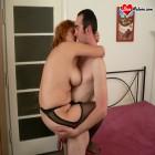 Red mature slut sucking a hard cock